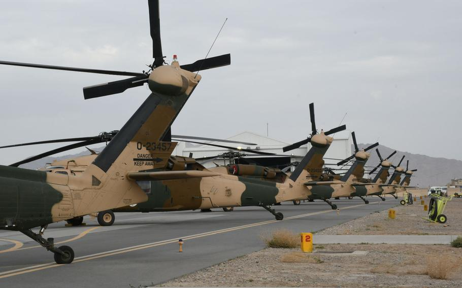 Some of Afghanistan's 11 UH-60 Back Hawks sit at Kandahar Air Filed, grounded by bad weather on Sunday, March 18, 2018.