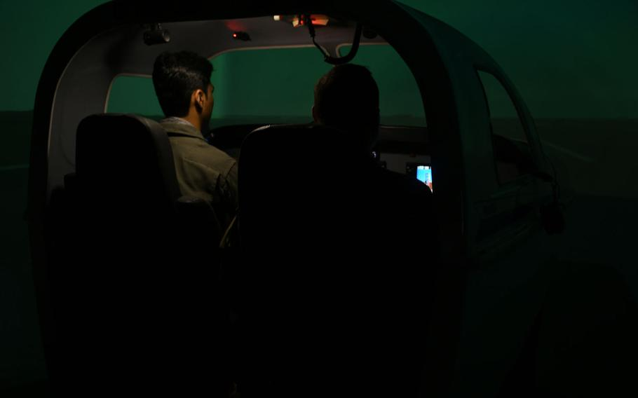 Afghan C208 pilot Capt. Naween, left, trains on an aircraft simulator at Hamid Karzai International Airport on Saturday, March 17, 2018. The U.S. is pushing the Afghans to become more proficient on the American-made aircraft as their Russian helicopters become unsustainable.