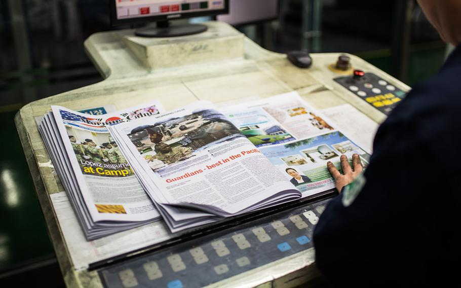A Morning Calm newspaper is inspected at a printing press at Bucheon, South Korea, Wednesday, March 21, 2018.