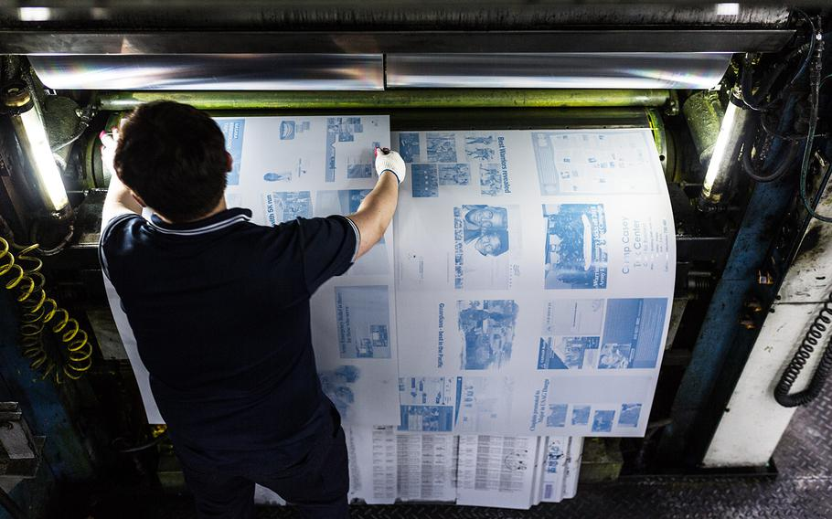 Morning Calm newspaper plates are placed onto a printing press in Bucheon, South Korea, Wednesday, March 21, 2018.