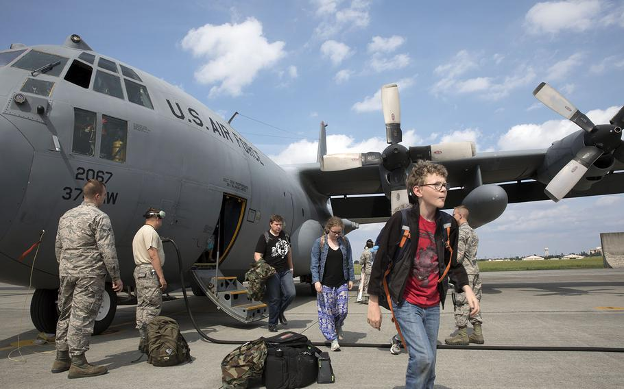U.S. military dependents from throughout the Korean Peninsula arrive at Yokota Air Base, Japan, during a noncombatant evacuation exercise last spring.