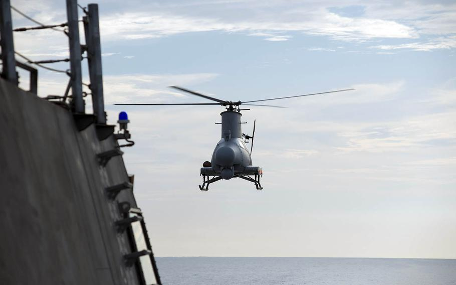 An MQ-8B Fire Scout drone prepares to land on the littoral combat ship USS Coronado last year in the South China Sea.