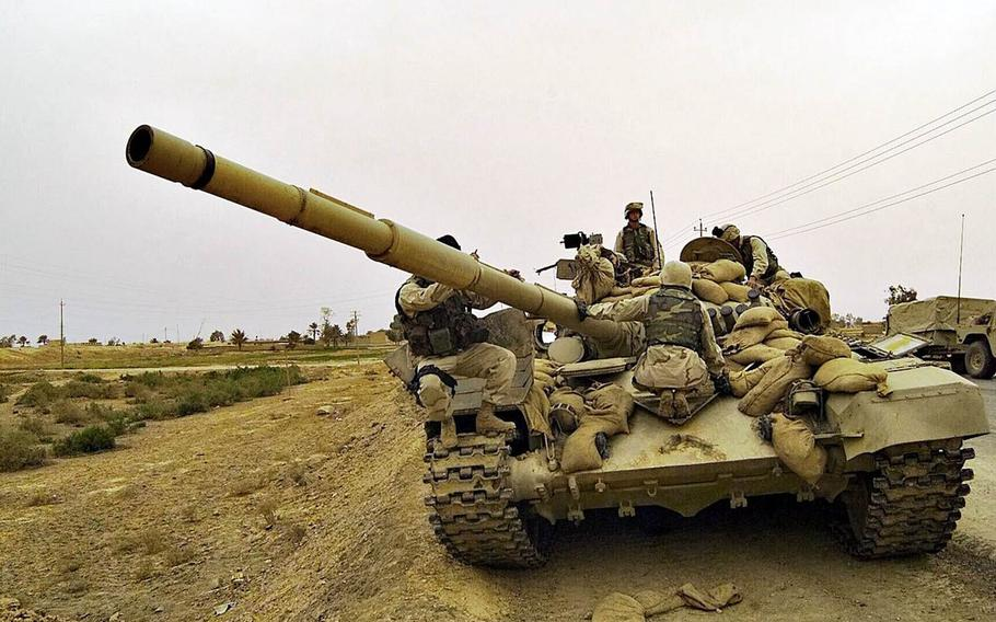 Marines taking part in Operation Iraqi Freedom find an abandoned T-72 tank in a suburb of Baghdad, April 8, 2003.