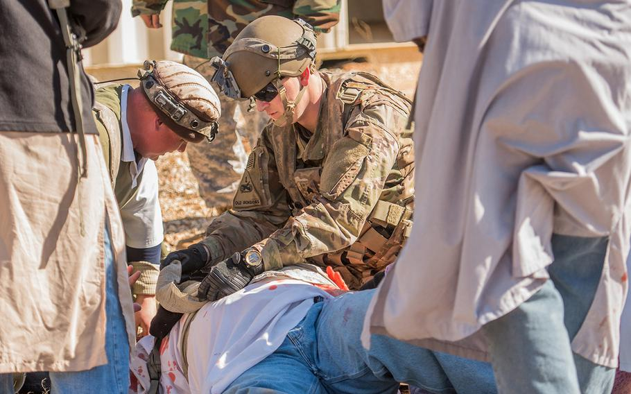 A U.S. Army sergeant with the 1st Security Force Assistance Brigade provides medical assistance to a role player portraying an Afghan national during a mission rehearsal exercise Jan. 15, 2018 at the Joint Readiness Training Center at Fort Polk in Louisiana. The 1st SFAB, the Army's first dedicated brigade of combat advisers, was preparing for a deployment this spring to Afghanistan.