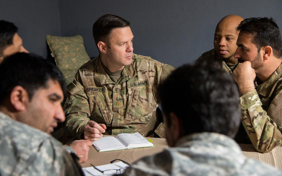 Army Maj. Brennan Speaks consults with Afghan-Americans portraying Afghan security forces during a training exercise for the 1st Security Force Assistance Brigade at the Joint Readiness Training Center at Fort Polk in Louisiana on Jan. 15. Speaks, the 1st SFAB's operations officer, and the brigade will aid Afghan soldiers this spring as Afghan forces launch offensives against the Taliban across the nation.