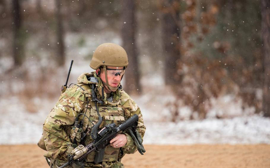 Snow falls as a soldier with the Army's 1st Security Force Assistance Brigade moves toward a mission objective during training Jan. 16 at the Joint Readiness Training Center at Fort Polk in Louisiana.