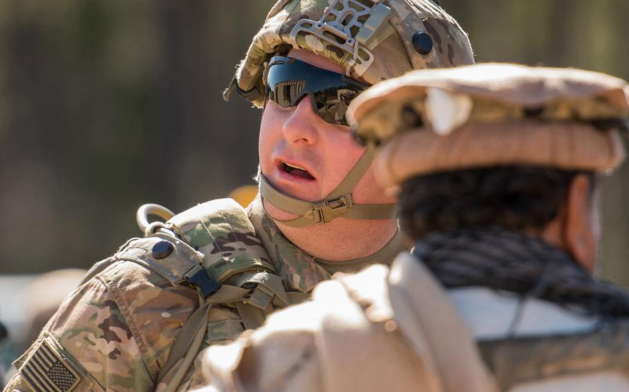 Army Capt. Christopher Young, a combat adviser team leader with the 1st Security Force Assistance Brigade, is pictured during a mission rehearsal exercise Jan. 15 at the Joint Readiness Training Center at Fort Polk, La. His combat adviser team was attacked in the scenario by a role player portraying a disgruntled Afghan police officer, leaving several Afghan civilians and soldiers and an American soldier wounded.