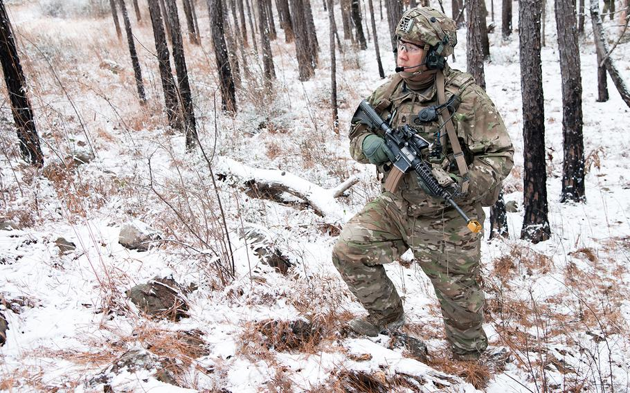 A soldier with the Army's 1st Security Force Assistance Brigade pauses during a patrol on a rare snowy day at the Joint Readiness Training Center at Fort Polk, La. as part of a training rotation Jan. 16.