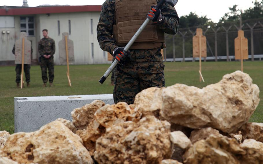 Lance Cpl. Eric Johnston participates in a Correctional Custody Unit demonstration at Camp Hansen, Okinawa, Jan. 12, 2018.