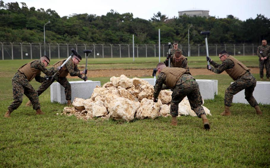 Marines put on a Correctional Custody Unit demonstration at Camp Hansen, Okinawa, Jan. 12, 2018.