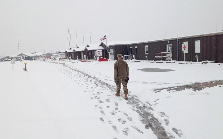 A U.S. soldier walks past the medical clinic at Camp Bondsteel in Kosovo on Thursday, March 22, 2018. Built after the 1999 Kosovo war, the austere base still has a makeshift feel. Built to house 7,000 troops, its population now is a fraction of that number.
