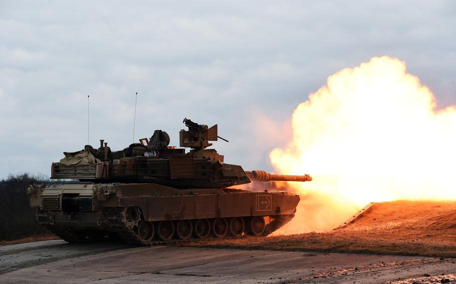 An M1A2 Abrams tank fires during a live-fire exercise at Grafenwoehr, Germany, Wednesday, March 28, 2018.