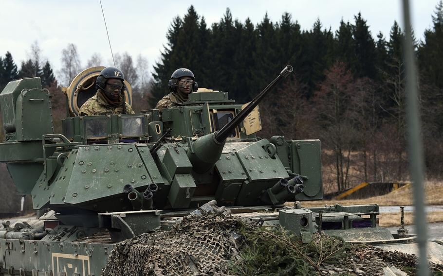 Soldiers with the 2nd Armored Brigade Combat Team in their Bradley Fighting Vehicle during a live-fire exercise at Grafenwoehr, Germany, Wednesday, March 28, 2018.