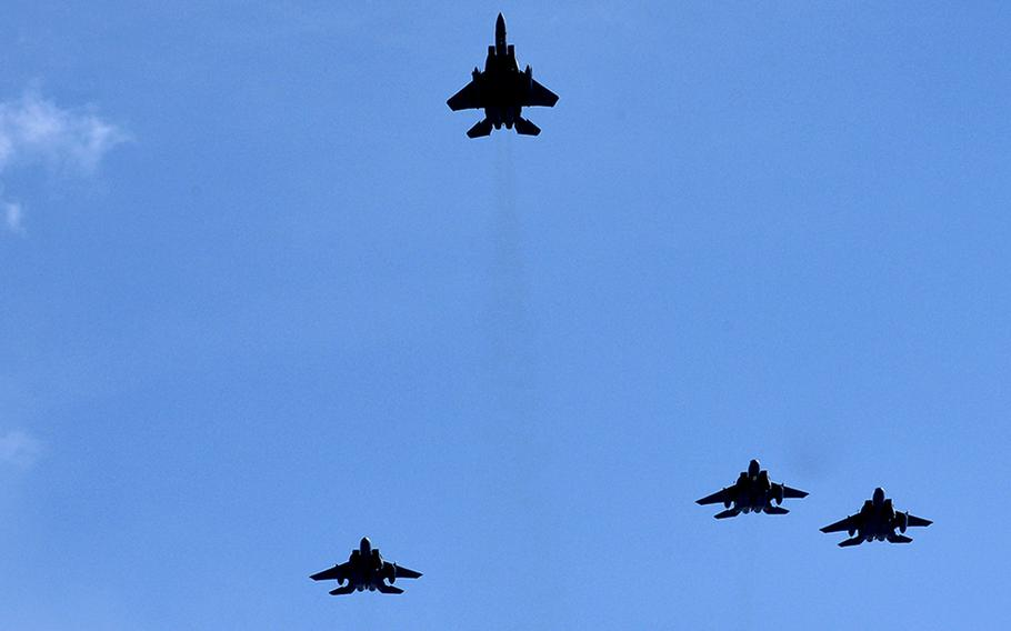 F-15s executing the Missing Man Formation. Thirty F-15C Eagles from the Air National Guard's 173rd Fighter Wing, at Kingsley Field, Ore., are scheduled to resume flight operations Thursday since being grounded over pilot safety concerns last week.