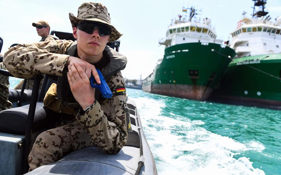 German Cpl. Virgilius Kolbeck demonstrates proper boarding techniques near Ghana on March 20, 2018, to prepare for Obangame Express, an eight-day multinational exercise designed to enhance cooperative policing in West African waters.