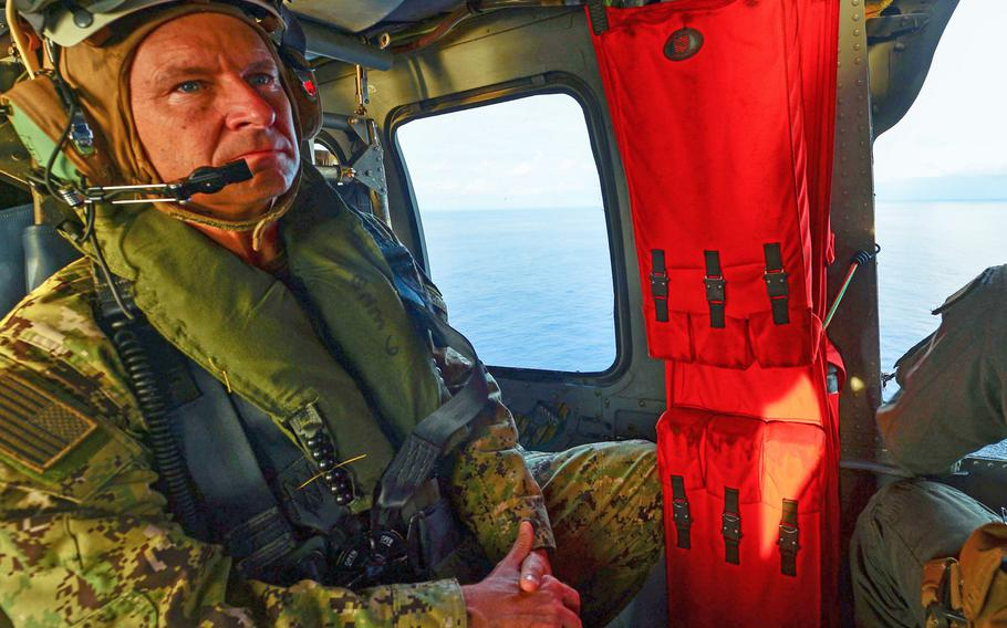 Rear Adm. Shawn Duane, 6th Fleet vice commander, rides in a Sea Hawk helicopter while conducting flight operations on March 24, 2018, during Obangame Express. Sponsored by U.S. Africa Command, 31 countries took part in the exercise designed to strengthen cooperative policing in West African waters.