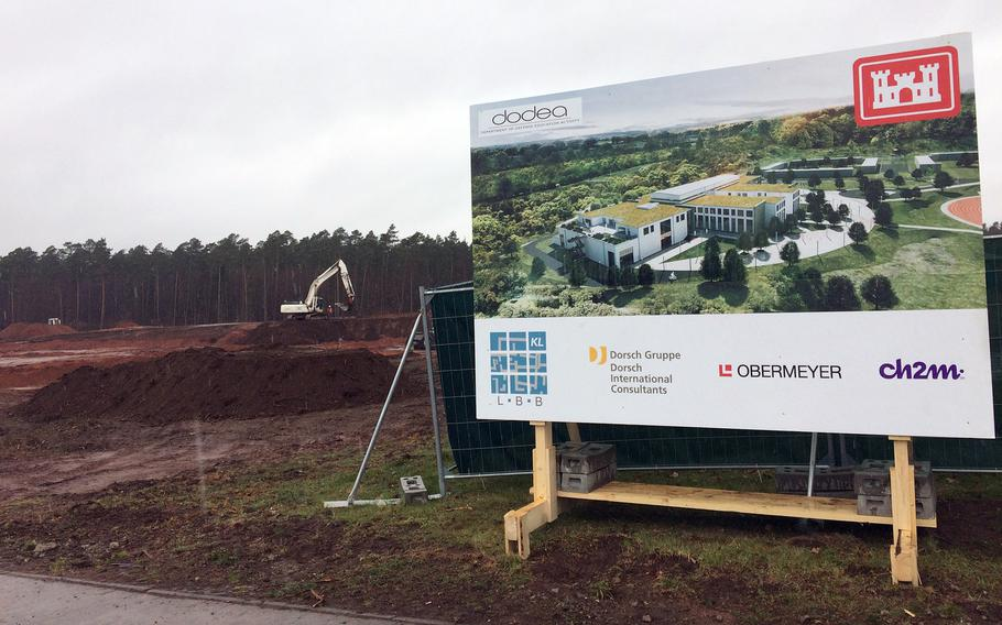 An architectural rending of the new Ramstein High School in Germany, as seen on March 28, 2018. In the background, construction crews have already started to dig up the ground where the new school will be built.