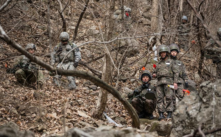 U.S. and South Korean forces investigate a site containing suspected unexploded ordnance at Pocheon, South Korea, Thursday, March 29, 2018.