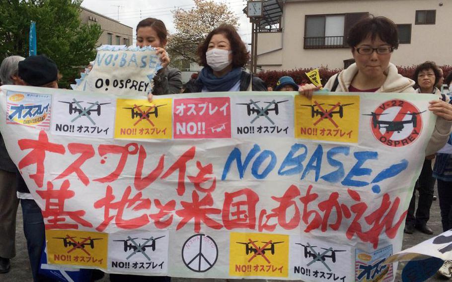 Japanese residents protest the presence of Air Force CV-22 Ospreys at Yokota Air Base, Japan, Friday, April 6, 2018.