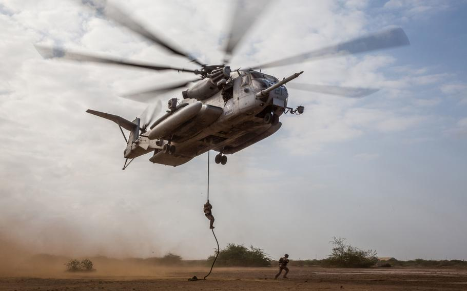 U.S. Marines fast-rope from a CH-53E Super Stallion during helicopter rope suspension technique training near Camp Lemonnier, Djibouti, Feb. 7, 2017. U.S. air operations in Djibouti remain grounded Friday after two Marine Corps aircraft  were involved in crashes earlier this week.