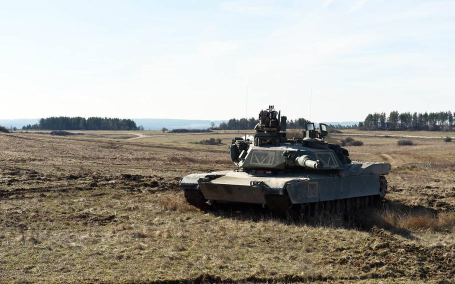 An M1A2 Abrams tank is ready to provide supressing fire during the Robotic Complex Breach Concept demonstration at Grafenwoehr, Germany, Friday, April 6, 2018.