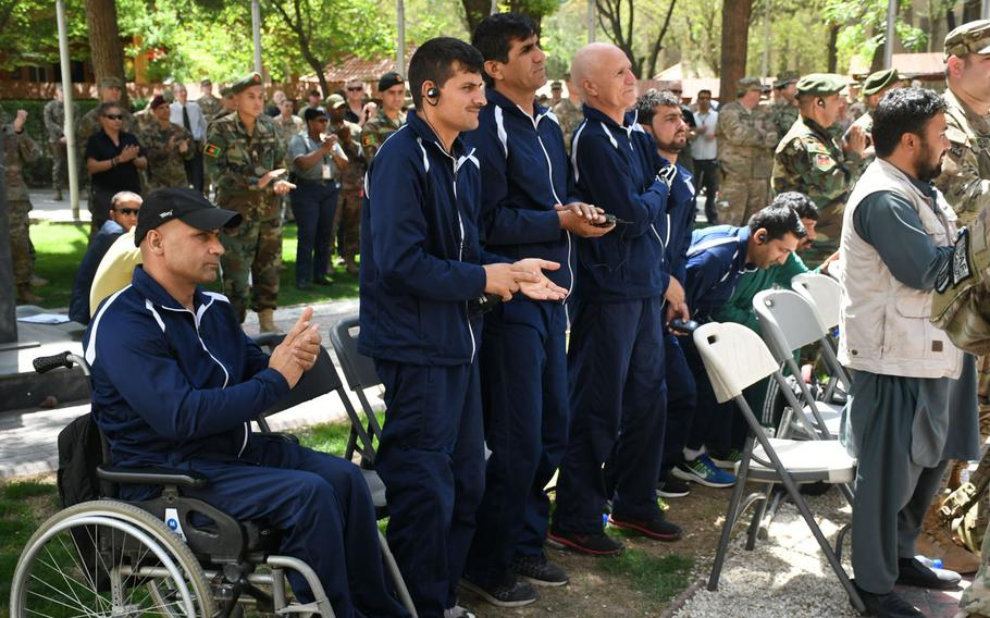 Wounded Afghan troops attend an operation Proper Exit ceremony at NATO's Resolute Headquarters in Kabul on Saturday, April 7, 2018.