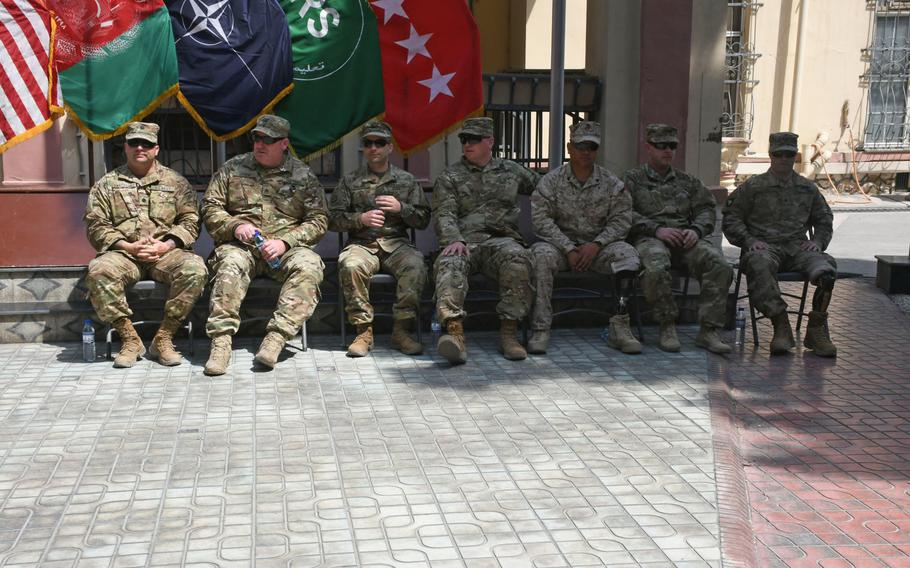 Navy Cmdr. William Danchanko, left, retired Army Staff Sgt. John Hosea, retired Army Staff Sgt. Jaymes Poling, retired Army Sgt. Franz Walkup, retired Marine Corps Sgt. Hubert Gonzalez, Army Sgt. Jonathan Harmon and retired Army Spc. Justin Lane participate in an operation Proper Exit ceremony at NATO's Resolute Support Headquarters in Kabul, Afghanistan on Saturday, April 7, 2018.   Phillip Walter Wellman/Stars and Stripes