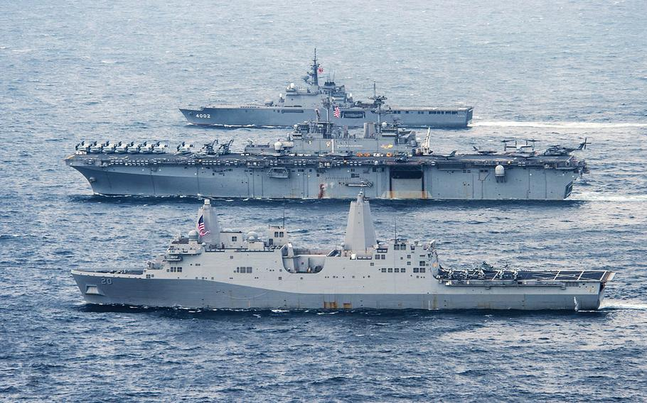 The USS Green Bay, front, the USS Wasp, center, and the JS Shimokita sail in formation in the East China Sea, Monday, April 9, 2018.