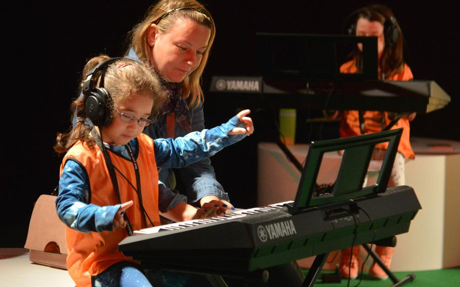 A young visitor to the Musikmesse in Frankfurt, Germany tries her hand at a keyboard Wednesday, April 11, 2018. In Hall 10 there is a section called ''Discovering Music,'' where youngsters can try a variety of instruments.