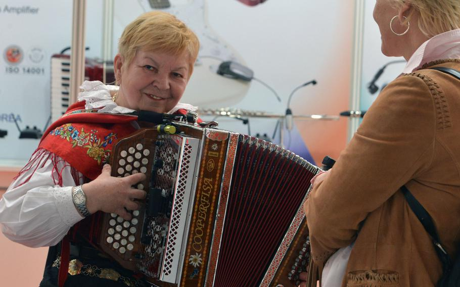 Music instruments from the traditional to the modern are on display at Musikmesse, the music trade fair in Frankfurt, Germany. Here, a musician plays the accordion for visitors
