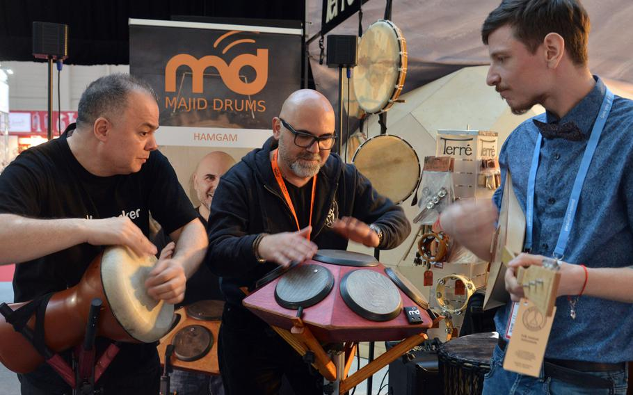 Musicians do what they do best at the Musikmesse in Frankfurt, Germany — play music. The instrument at center is called a hangar. It offers 7 tunable playing surfaces to the player, who in this case is percussionist Tony Liotta.