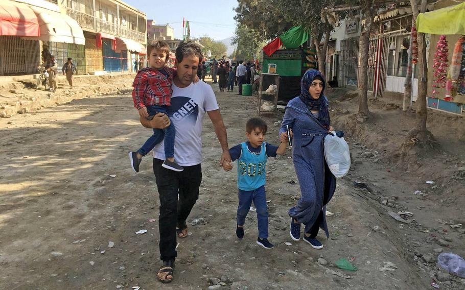 A family evacuates the area around the Shiite Hussainia Mosque in Kabul after a suicide attack. Civilian casualties in Afghanistan remained near record levels during the first three months of the year, according to the United Nations mission in the country, which released data on Thursday.