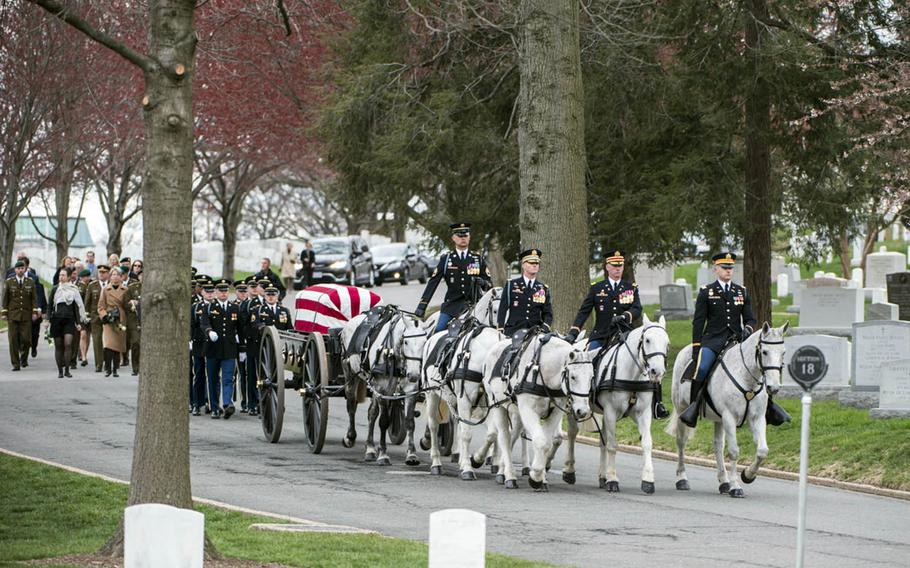 """The 3rd U.S. Infantry Regiment Caisson Platoon, known as """"The Old Guard,"""" escorts a former Army colonel to his final resting place at Arlington National Cemetery, April 2, 2018."""