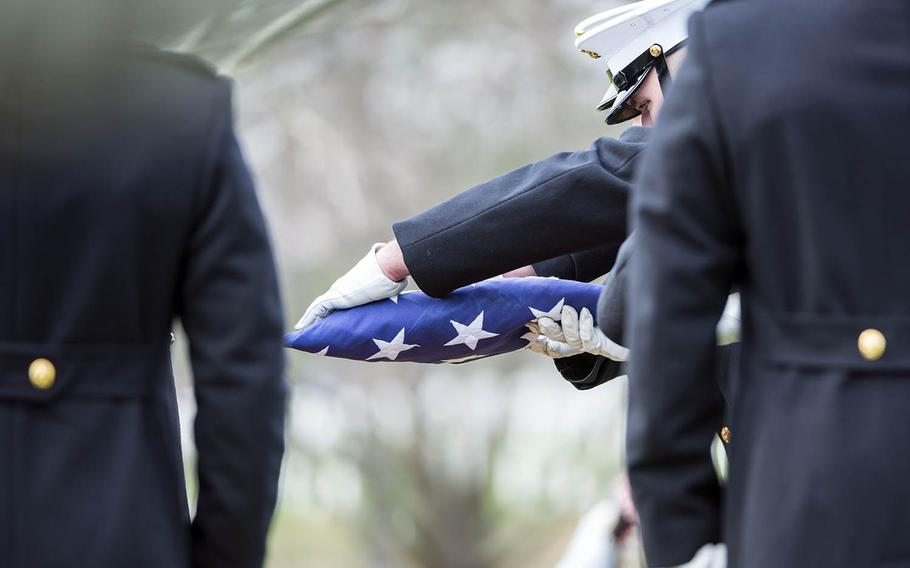 A full-honors funeral takes place at Arlington National Cemetery, Monday, April 9, 2018.