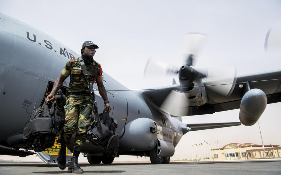 A Burkina Faso soldier exits a U.S. Air Force C-130H Hercules at Diori Hamani International Airport, Niger, April 10, 2018. Approximately 1,900 servicemembers from more than 20 African and western partner nations are participating in Flintlock 2018 at multiple locations in Niger, Burkina Faso and Senegal.