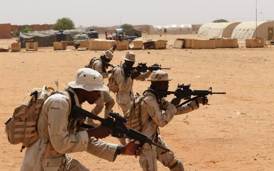 A squad of Senegalese soldiers assaults the objective in a small unit tactics class during Flintlock 2018 in Tahoua, Niger, April 12, 2018.