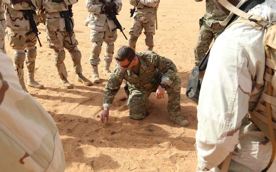 Staff Sgt. Kyle, a U.S. Army Special Forces Operational Detachment Alpha communications sergeant in 3rd Special Forces Group, uses rock drills to explain small unit tactics to Senegalese soldiers during Flintlock 2018 in Tahoua, Niger, April 12, 2018. Flintlock is an annual, African-led, integrated military and law enforcement exercise.