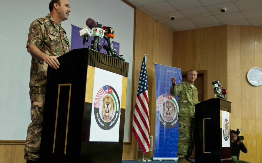 Jordan Armed Forces Brig. Staff Gen. Mohommad Al-Thalji and U.S. Air Force Maj. Gen. Jon Mott, co-directors of Exercise Eager Lion 2018, announce the beginning of the exercise at an April 15 international press conference at the Jordan Special Operations Command near Amman, Jordan.