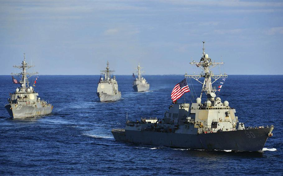The guided-missile destroyer USS Chafee, right, leads the USS Stethem, the USS Princeton and the USS Sampson while transiting the Western Pacific last November.