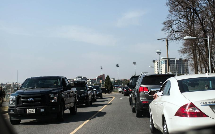 Traffic backs up at Camp Humphreys, South Korea, after a false report that a vehicle ran one of the gates, Wednesday, April 18, 2018.