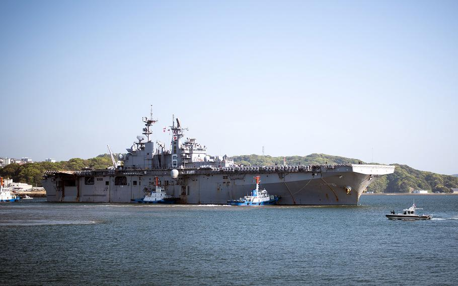 The USS Bonhomme Richard departs Sasebo Naval Base, Japan, Wednesday, April 18, 2018, after a six-year deployment.