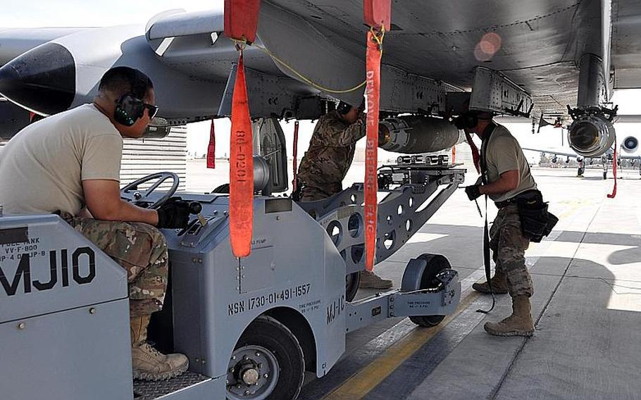 Tech. Sgt. Nathan Wesley, Airman 1st Class Rey Nino Estrella and Airman Carlito Yalon, a weapons loader assigned to the 303rd Expeditionary Fighter Squadron, load a 500-pound GPS-guided bomb on an A-10 Thunderbolt II before a mission at Kandahar Airfield, Afghanistan, Feb. 10, 2018.