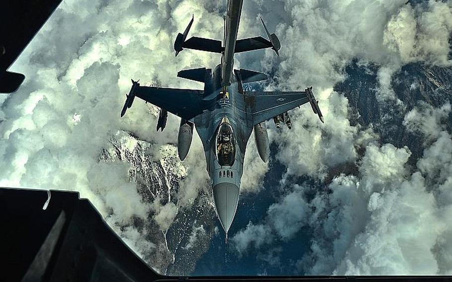 A U.S. Air Force F-16 Fighting Falcon pilot assigned to the 455th Air Expeditionary Wing, Bagram Air Field, Afghanistan, prepares to receive fuel over Afghanistan from a KC-10 Extender, March 9, 2018.