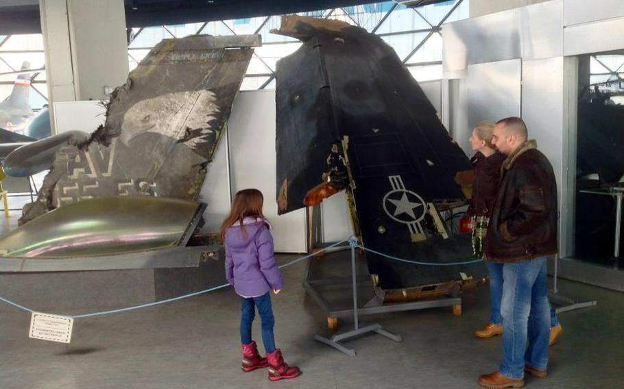 Visitors at Belgrade's air force museum view the wreckage of an F-117 stealth attack jet downed during the U.S.-led NATO bombing campaign against Serbia in 1999. On the left is the tail and canopy of an F-16 piloted during that campaign by Gen. David Goldfein, the current Air Force Chief of Staff.