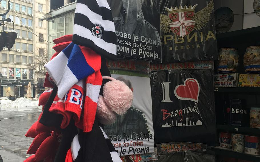 Street vendors in downtown Belgrade sell T-shirts with the image of Russian President Vladimir Putin. Russian influence in the Balkan republic has been steadily growing in the past several years.