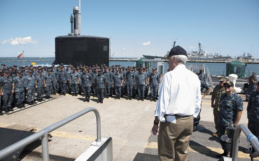 Secretary of the Navy Richard V. Spencer holds an all-hands call after a tour aboard the USS John Warner in Norfolk, Va., Aug. 10, 2017.