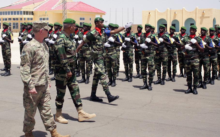 Maj. Gen. Marcus Hicks, leader of Special Operations Command Africa, left, reviews local troops in formation during a visit Thursday to Flintlock 2018 headquarters in Agadez, Niger. Flintlock, which ended Friday, is the largest U.S. special operations exercise in Africa and comes at a time when commanders are worried that extremist groups in the region are gaining momentum.