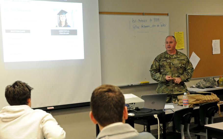 Soldiers talk with students at Arlington High School, Washington, in 2015. The Army recently issued a policy stressing the need to protect personally identifiable information when recruiting.