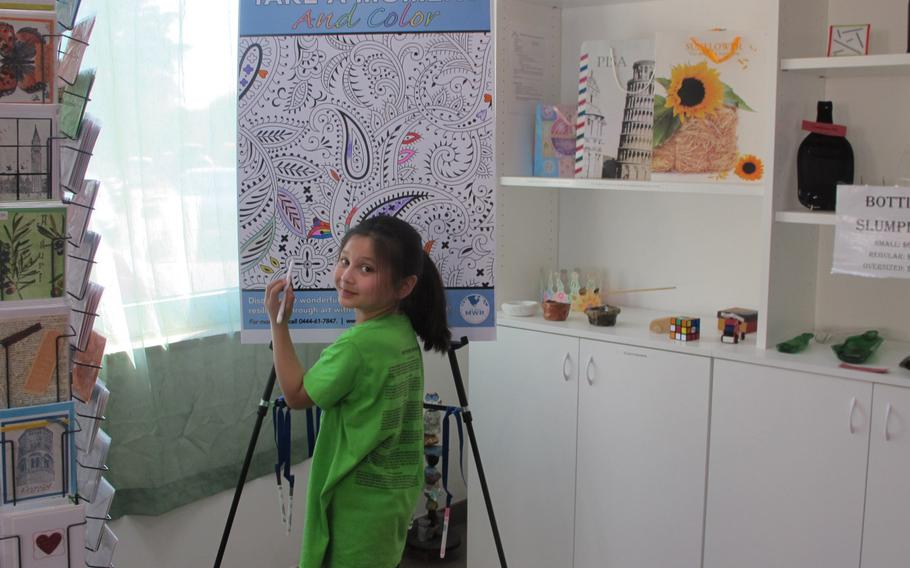 Jasmyne Holcombr takes a moment to color at the Vicenza Arts and Craft Center. The Vicenza center staff wants to put coloring boards and chalkboards in spaces such as lawyers' and doctors' waiting areas throughout the base to engage and relax people.