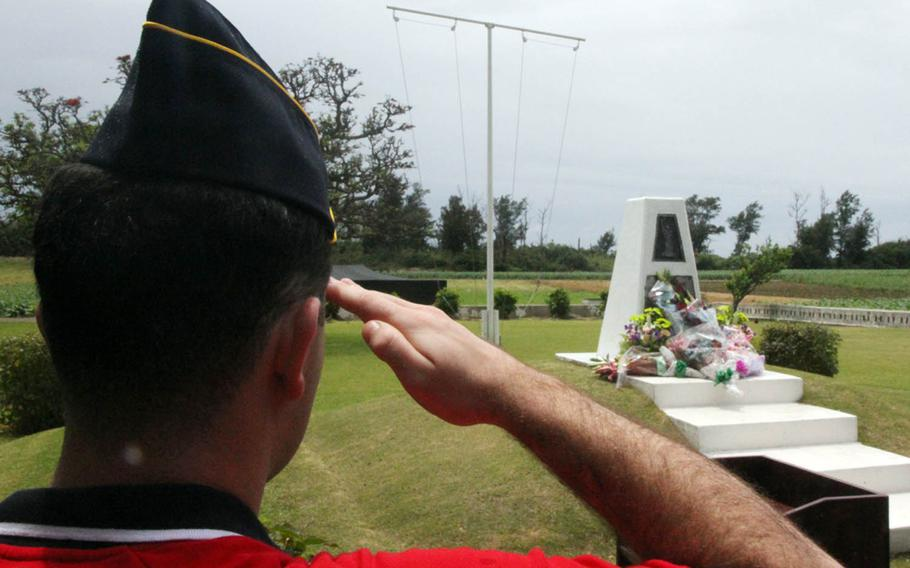 A member of American Legion Post 28 in Okinawa, Japan, renders salute during a ceremony honoring famed war correspondent Ernie Pyle, in Okinawa, Japan, Sunday, April 23, 2018.
